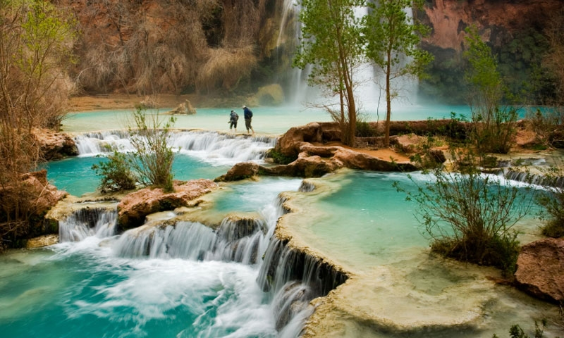 Walking along the base of Havasu Falls